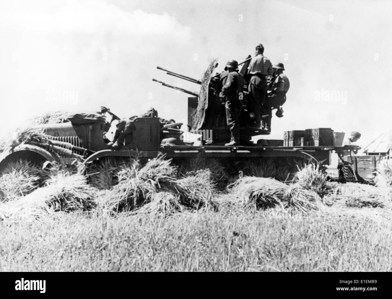 The picture from Nazi news reporting shows German soldiers crewing an anti-aircraft gun for the defence against Stock Photo