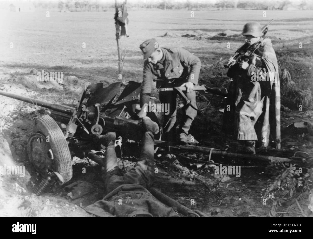 Propaganda text! from Nazi news reporting on the back of the picture: 'Out of action. The German shell detonated Stock Photo
