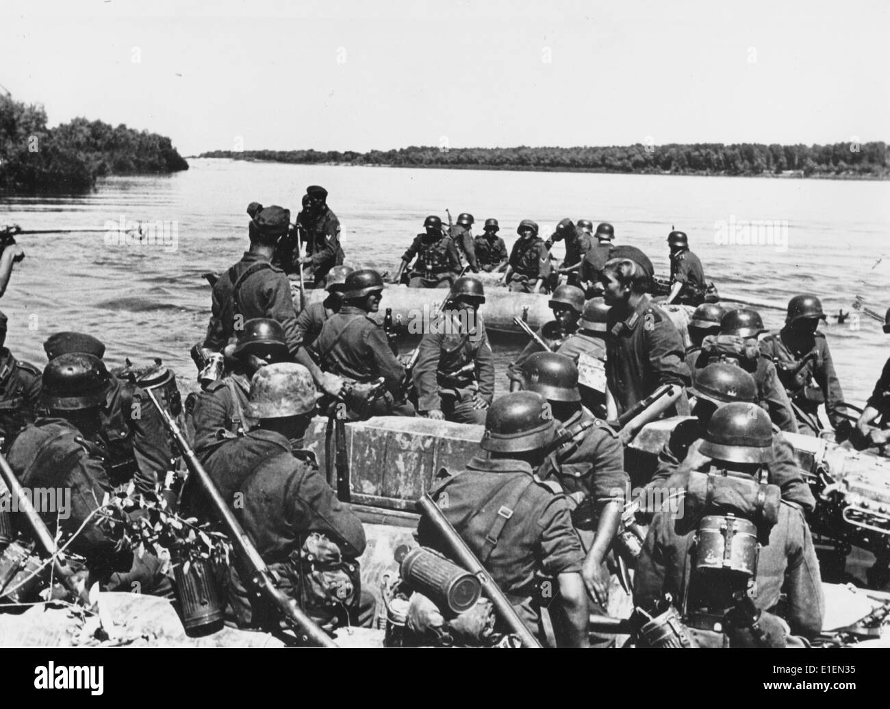 Propaganda text! from Nazi news reporting on the back of the picture: 'With assault boats across the Don River.' Stock Photo