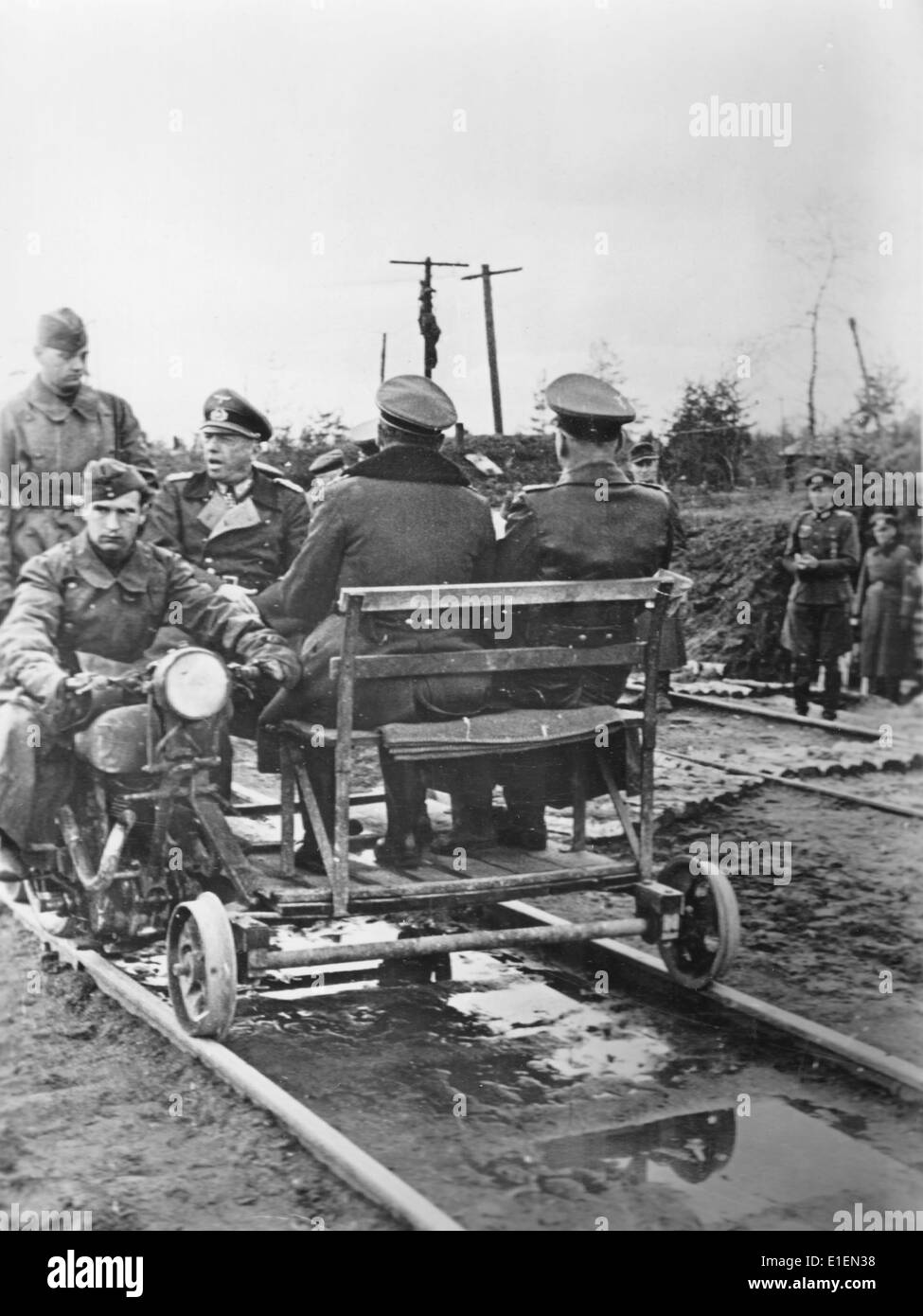 Propaganda text! from Nazi news reporting on the back of the picture: 'With the draisine to the front. The paths and roads, which especially during inclement weather are impassable in many cases, have made the draisine a frequently used means of transport. Even the commander-in-chief of an army group, Field marshal Kuechler, uses such a vehicle for his inspections of the front.' Picture taken at the Eastern Front on 10 June 1943. (Flaws in quality due to the historic picture copy) Photo: Berliner Verlag/Archive - NO WIRE SERVICE – - Stock Image