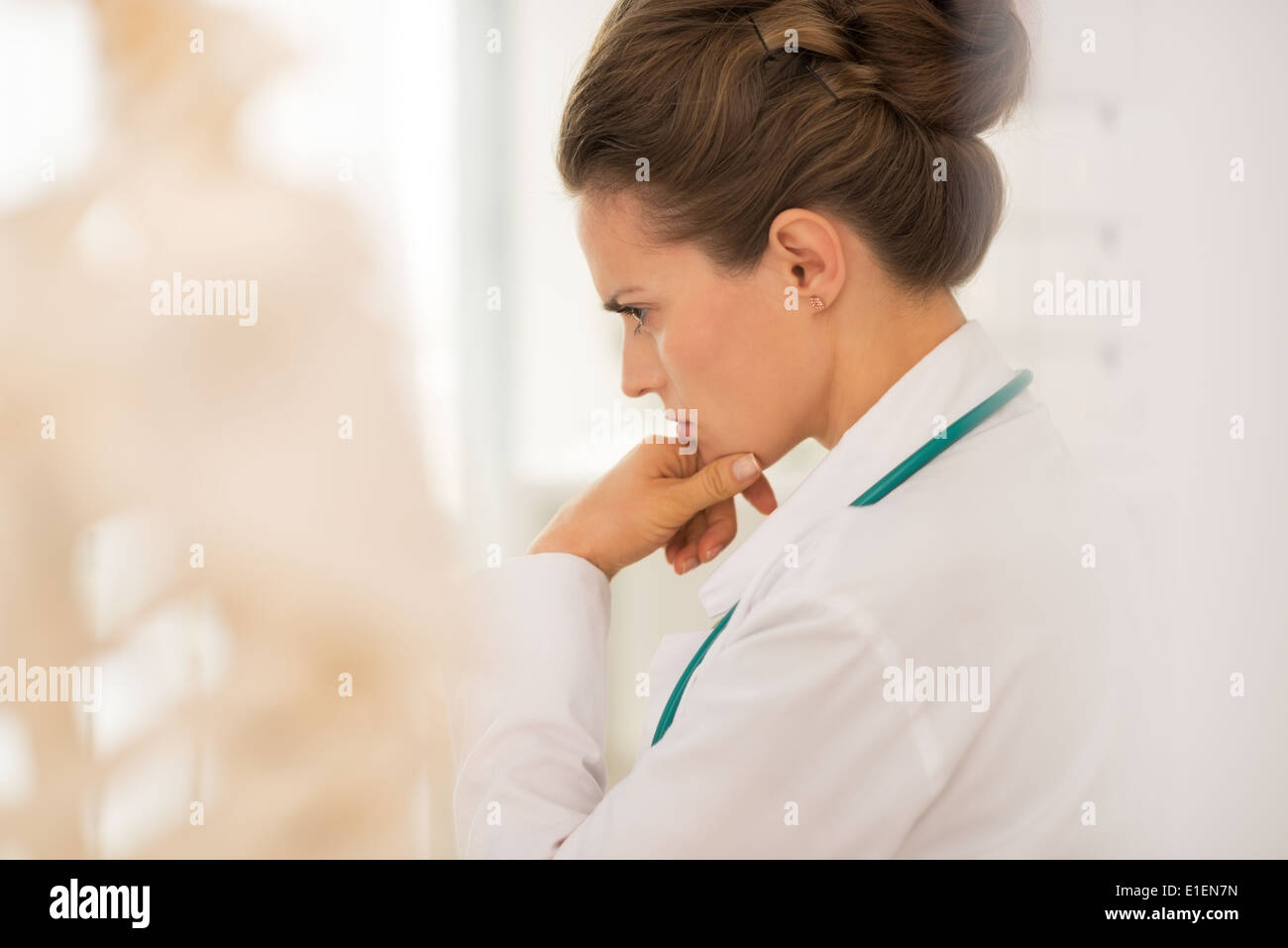 Portrait of thoughtful medical doctor woman Stock Photo