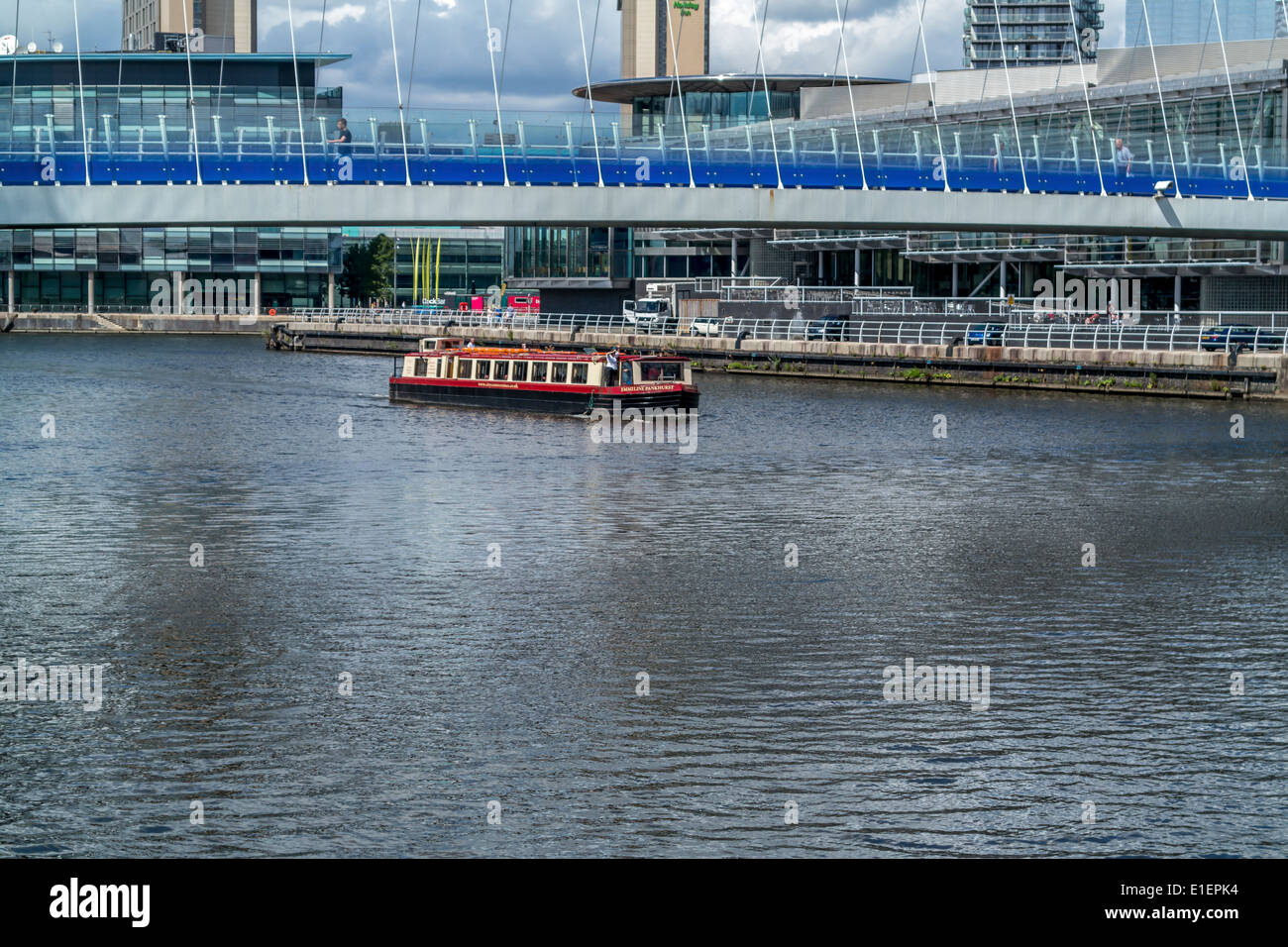 Small pleasure cruiser on the Manchester Sip Canal - Stock Image