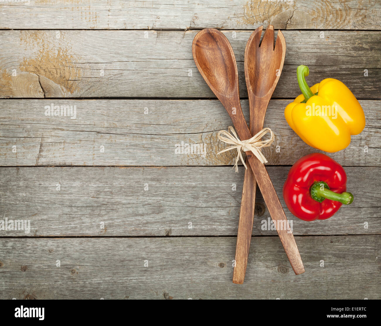 Kitchen Utensils Background: Colorful Bell Peppers And Kitchen Utensils Over Wooden