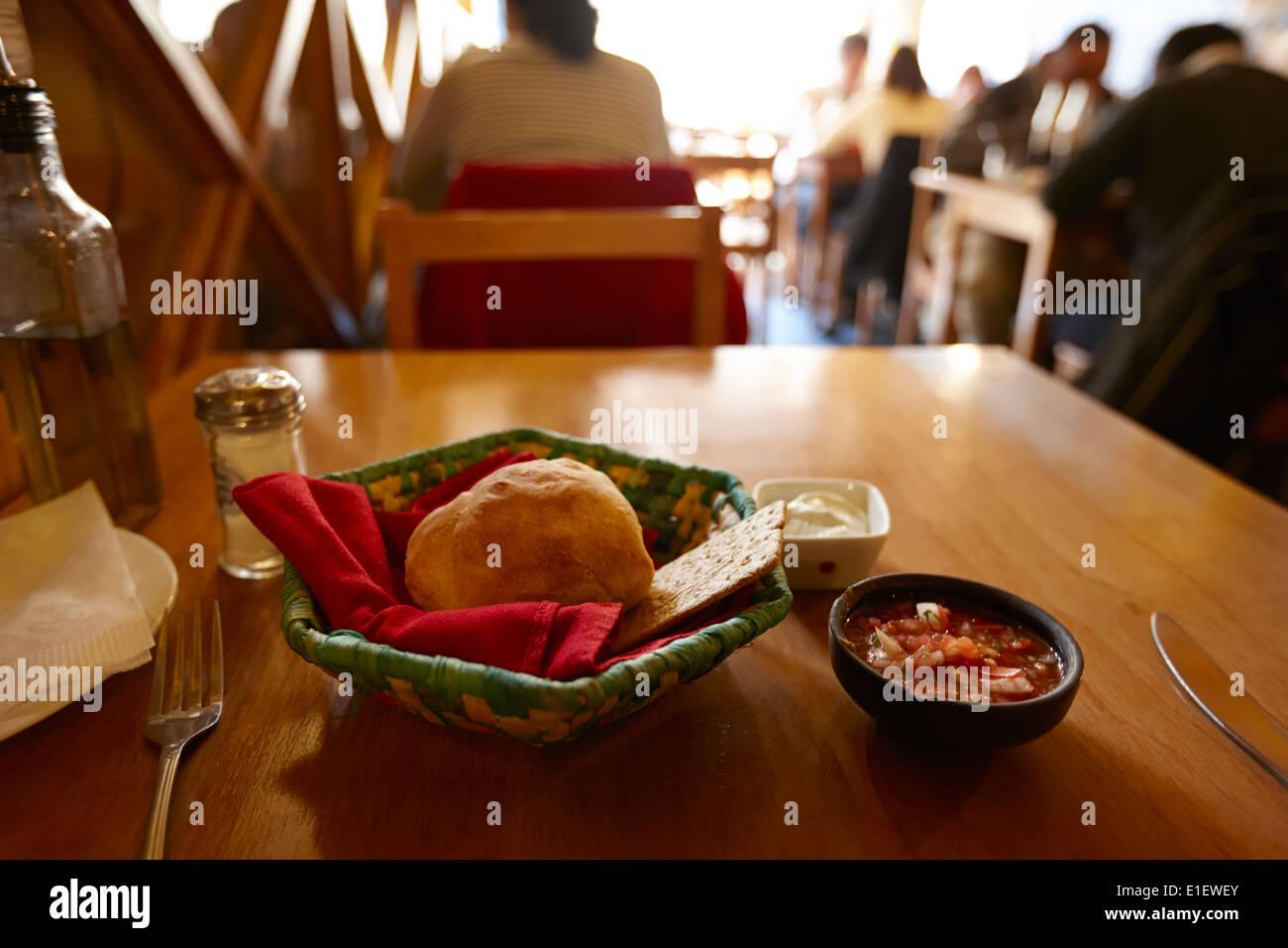 breads and salsa inside la luna restaurant Punta Arenas Chile - Stock Image