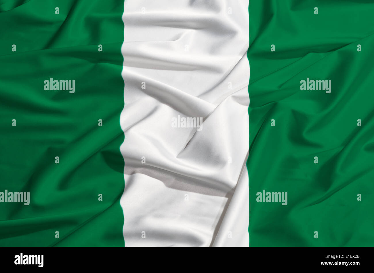 Nigeria flag on a silk drape waving - Stock Image