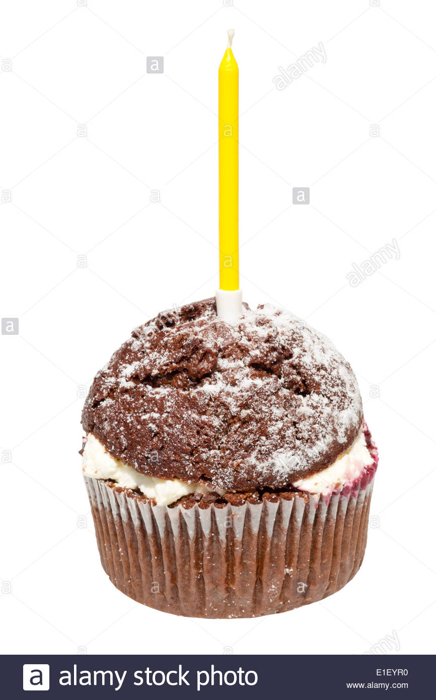 Chocolate muffin with a birthday candle cut out against a white background. - Stock Image
