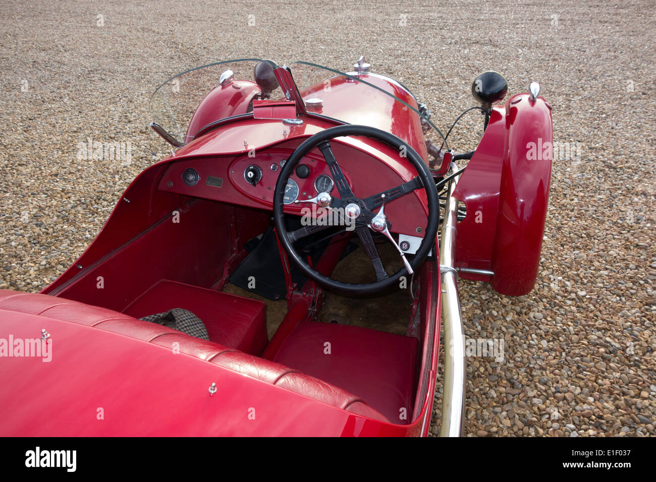 Cockpit driving seat of a Vintage Morgan 3-wheeled V-twin engined motor car Stock Photo