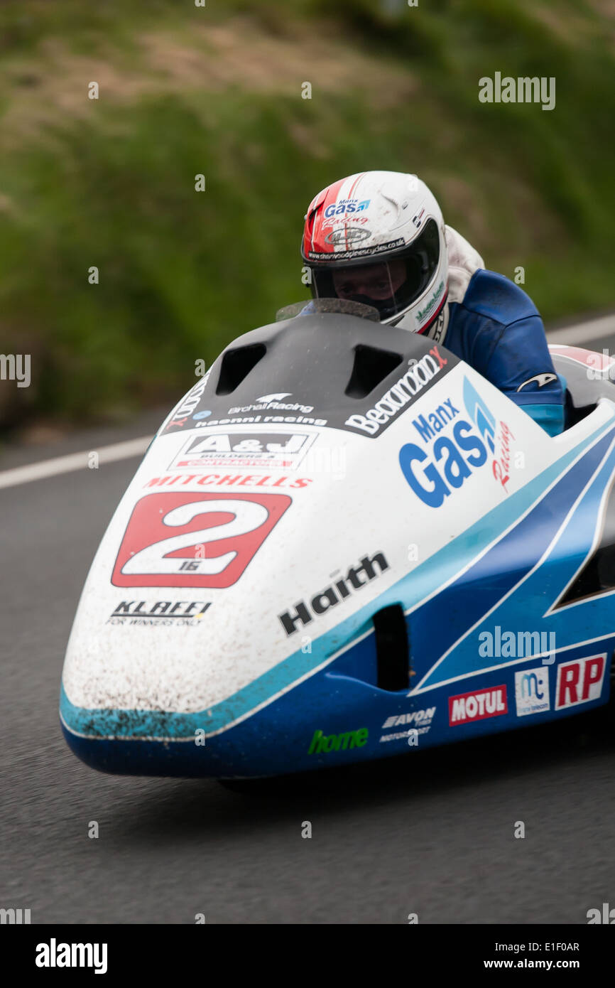 Ben Birchill pilots his sidecar as it accelerates out of Creg-Ny-Baa corner during practice week of the 2014 IOM Stock Photo