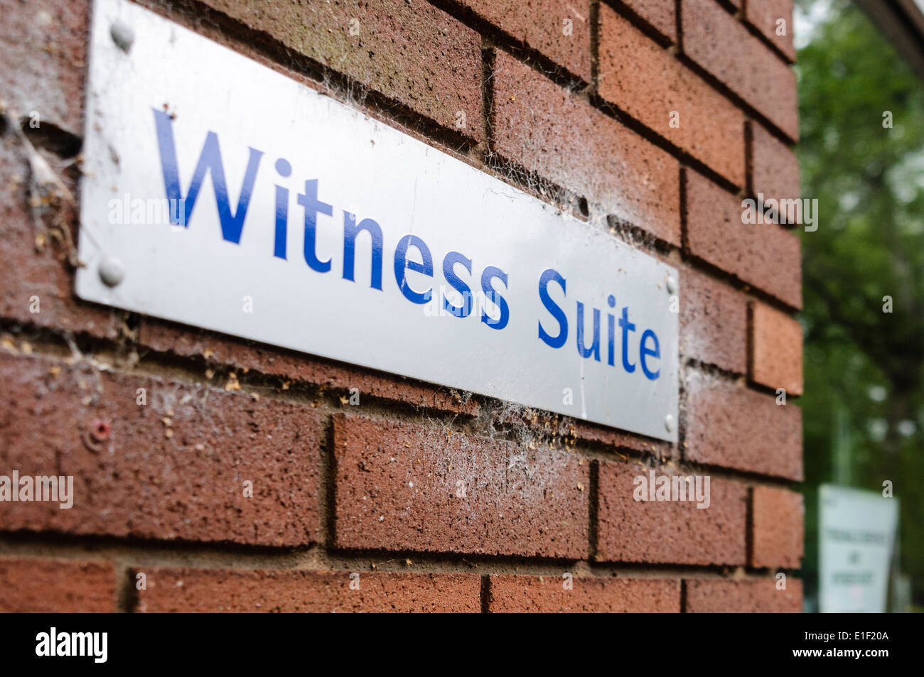Sign at the entrance to a Witness Suite at a courthouse in the United Kingdom - Stock Image