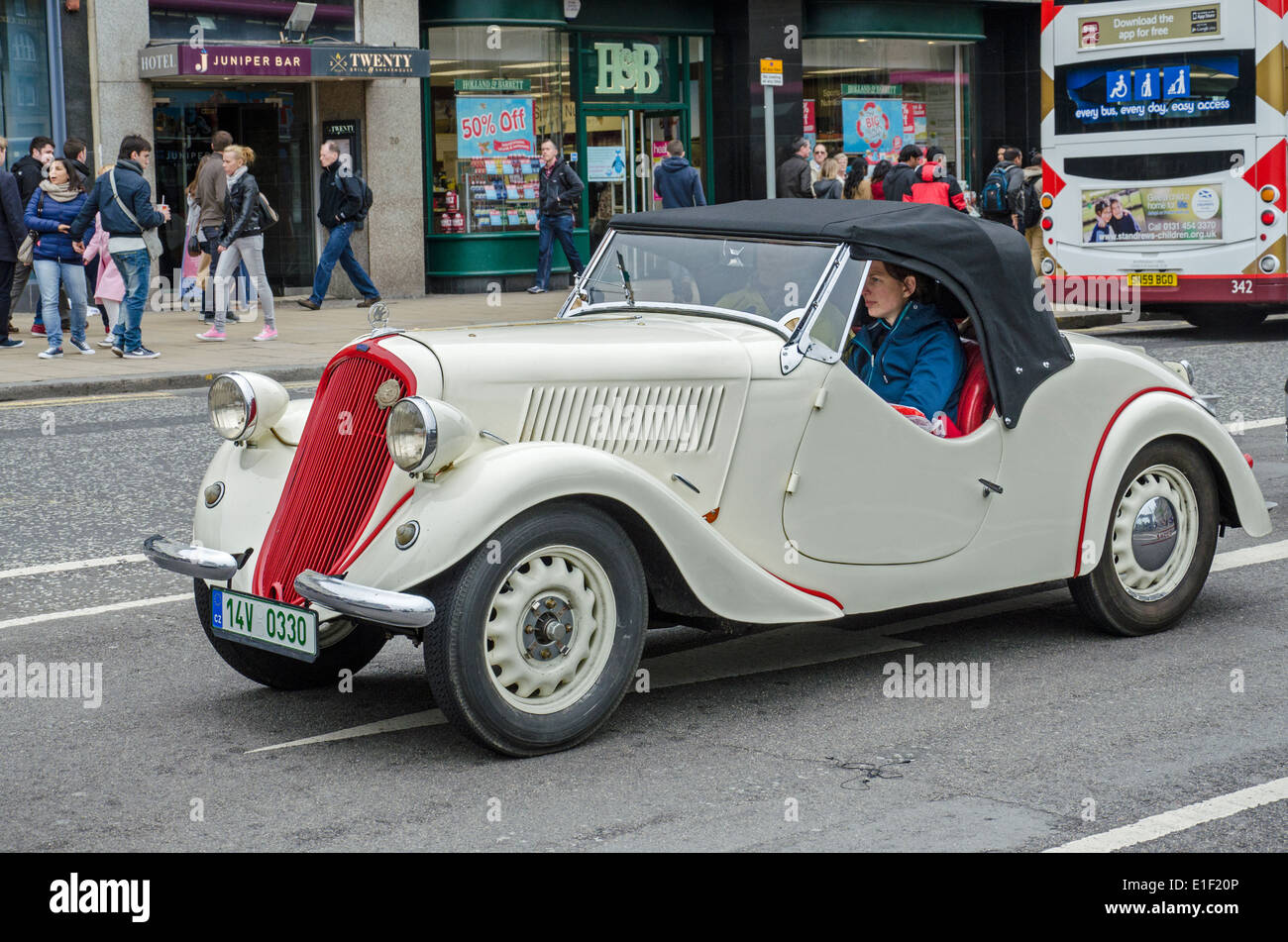 A two-seater convertible sportcar made by Škoda being driven along Princes Street in the centre of Edinburgh, Scotland, UK. - Stock Image