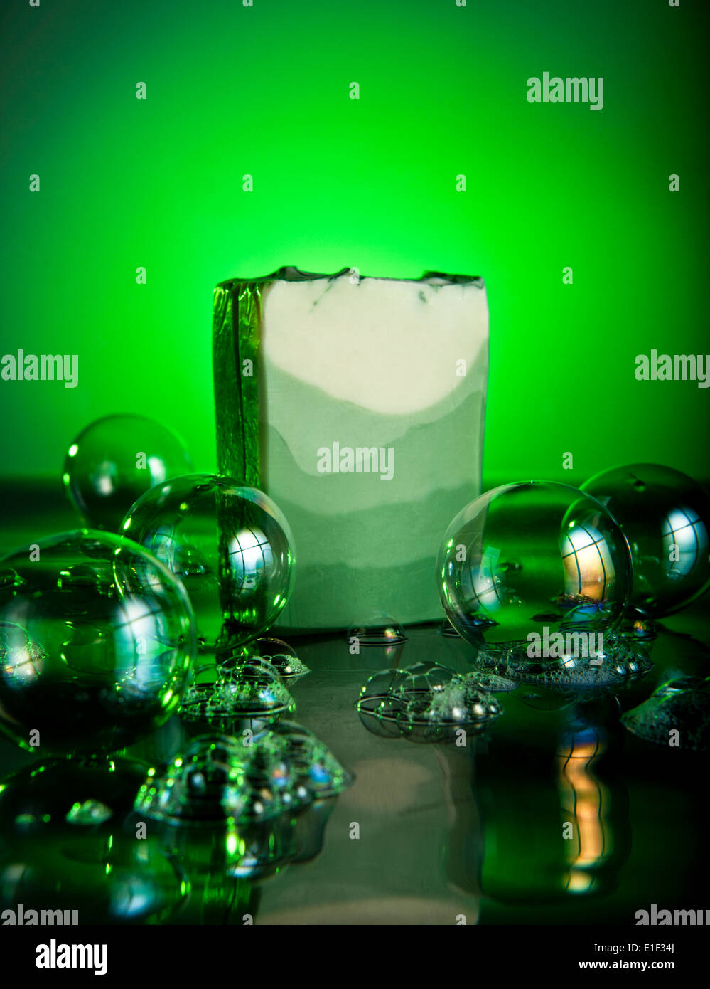 Hand Crafted Soap with bubbles and green lighted background. This image can be used in a set with E1F24F and E1E5RE - Stock Image