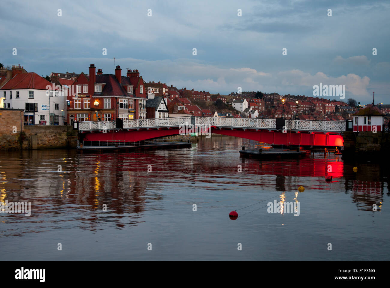 The swing bridge over the River Esk at dusk. Whitby, North Yorkshire. March. - Stock Image