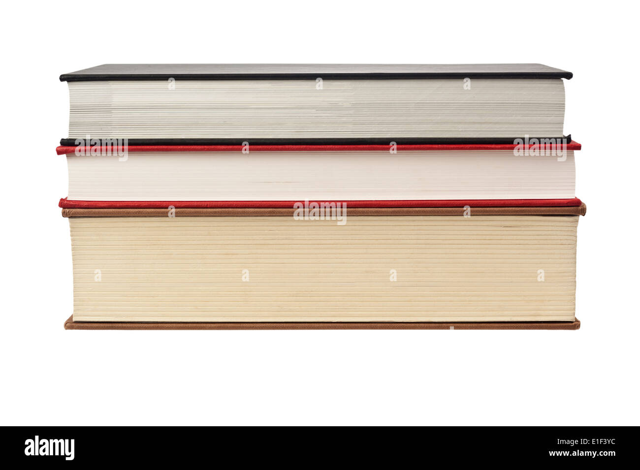 Closeup of the fore edge of three books isolated on white background - Stock Image