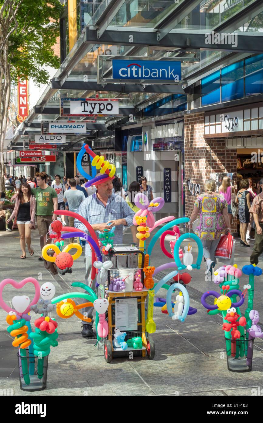 Brisbane Australia Queensland Central Business District CBD Queen Street Mall shopping pedestrian balloon man sculptor vendor - Stock Image