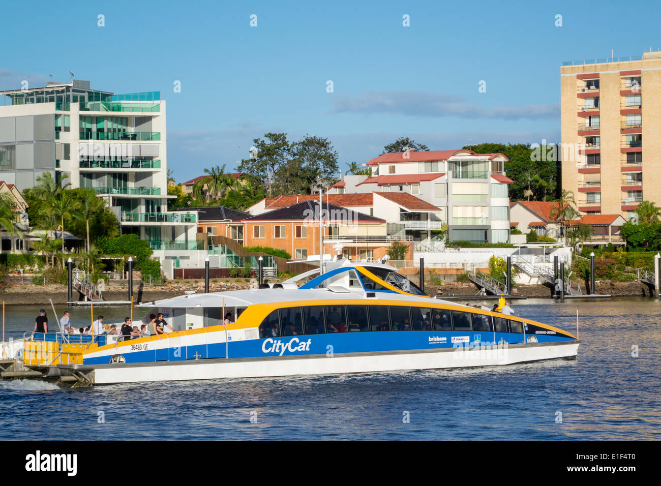 Brisbane Australia Queensland Brisbane River New Farm apartment buildings residences waterfront Brisbane Ferries ferry service CityCat boat - Stock Image
