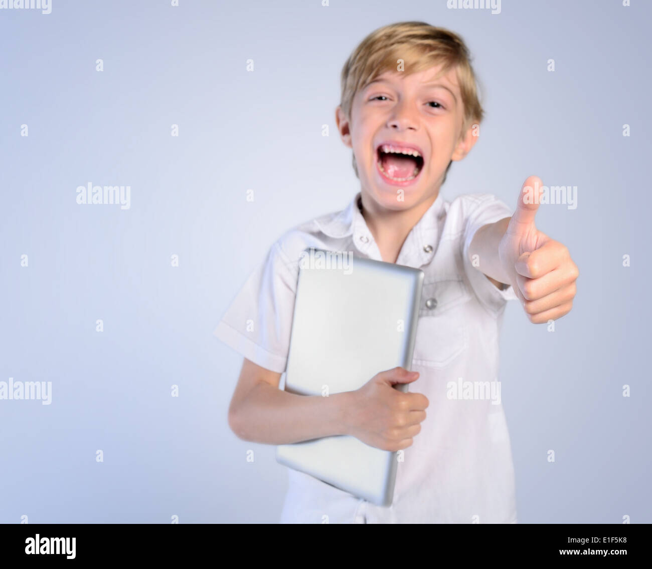 adorable agreement appreciation approval background casual child childhood congratulation cute fun excellent gesture glad good g - Stock Image