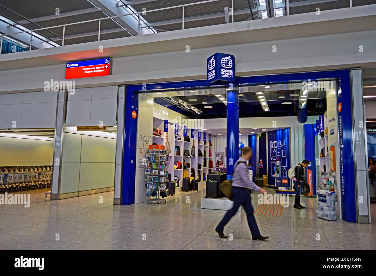 Excess Baggage Company, Terminal 5 Departures, Heathrow Airport, London Borough of Hillingdon, London, England, United Kingdom - Stock Image