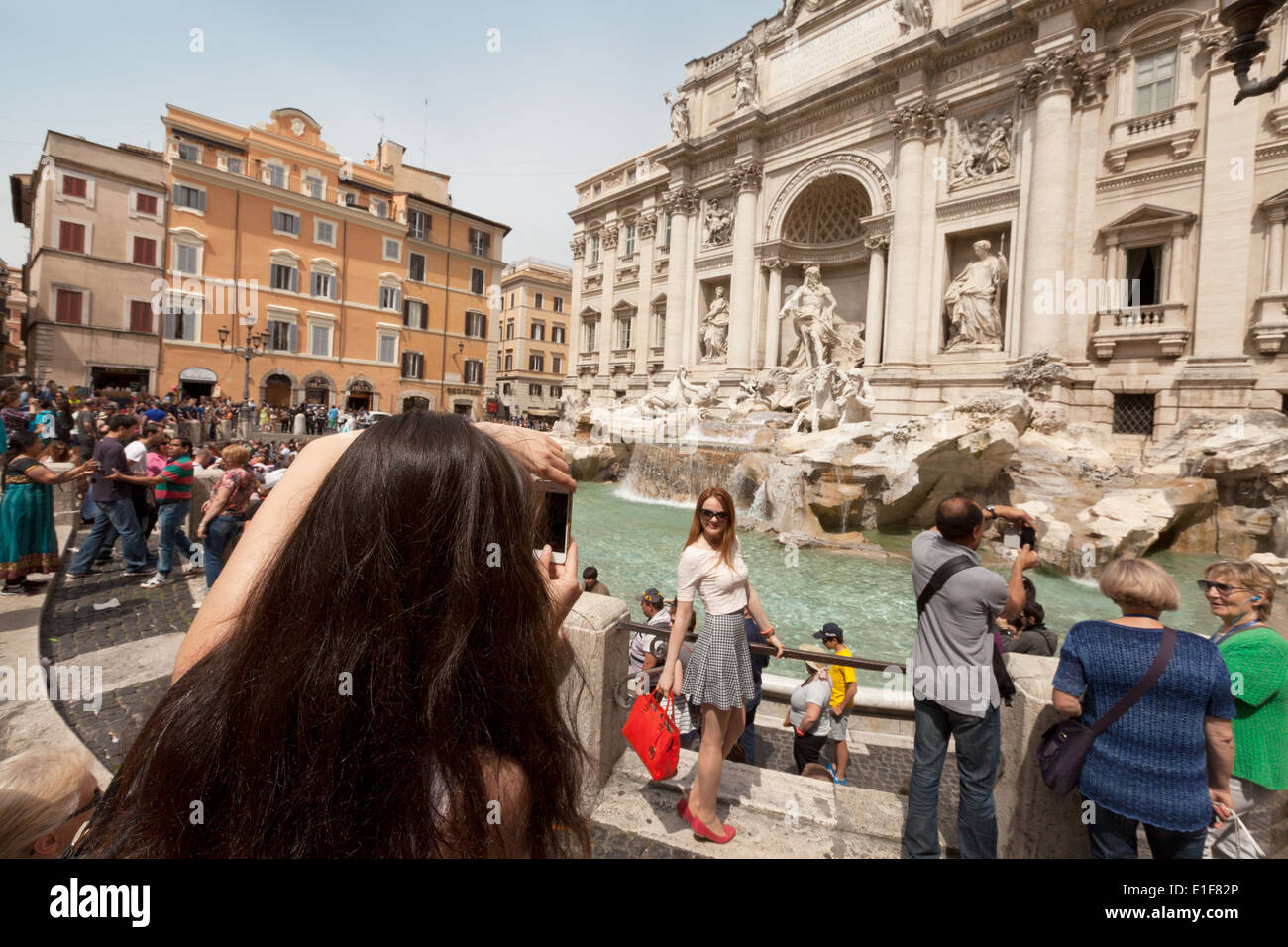 People taking photos at the Trevi fountain, Rome Italy Europe - Stock Image