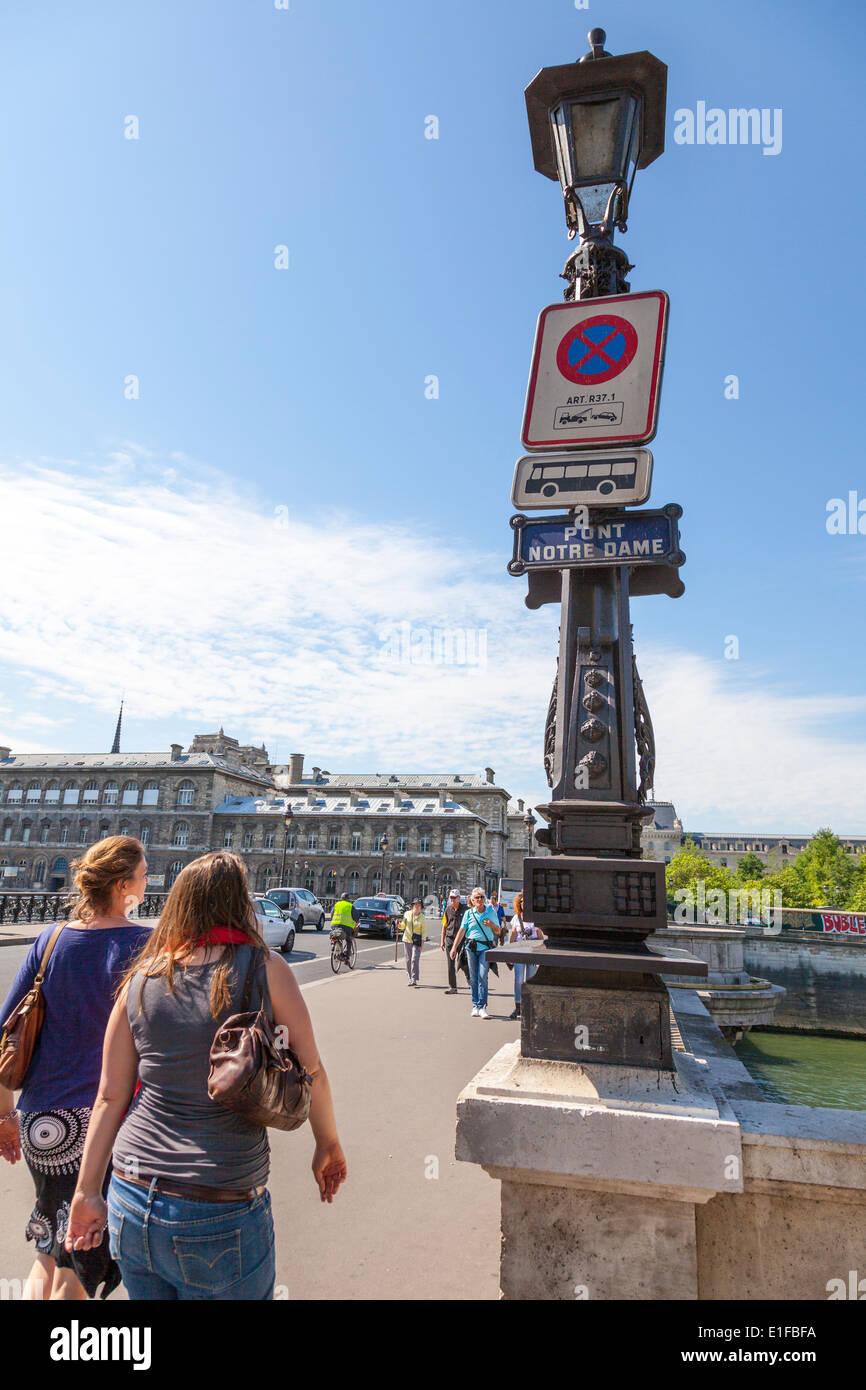 Pont Notre Dame Paris France bridge sign light pedestrians tourists tourism - Stock Image