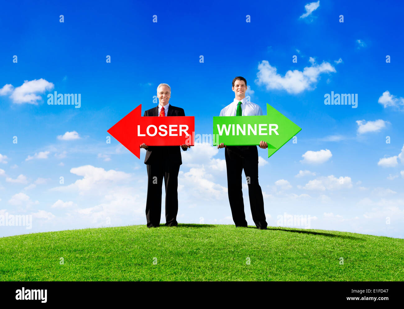Two Businessmen Holding Contrasting Arrows for Loser and Winner - Stock Image