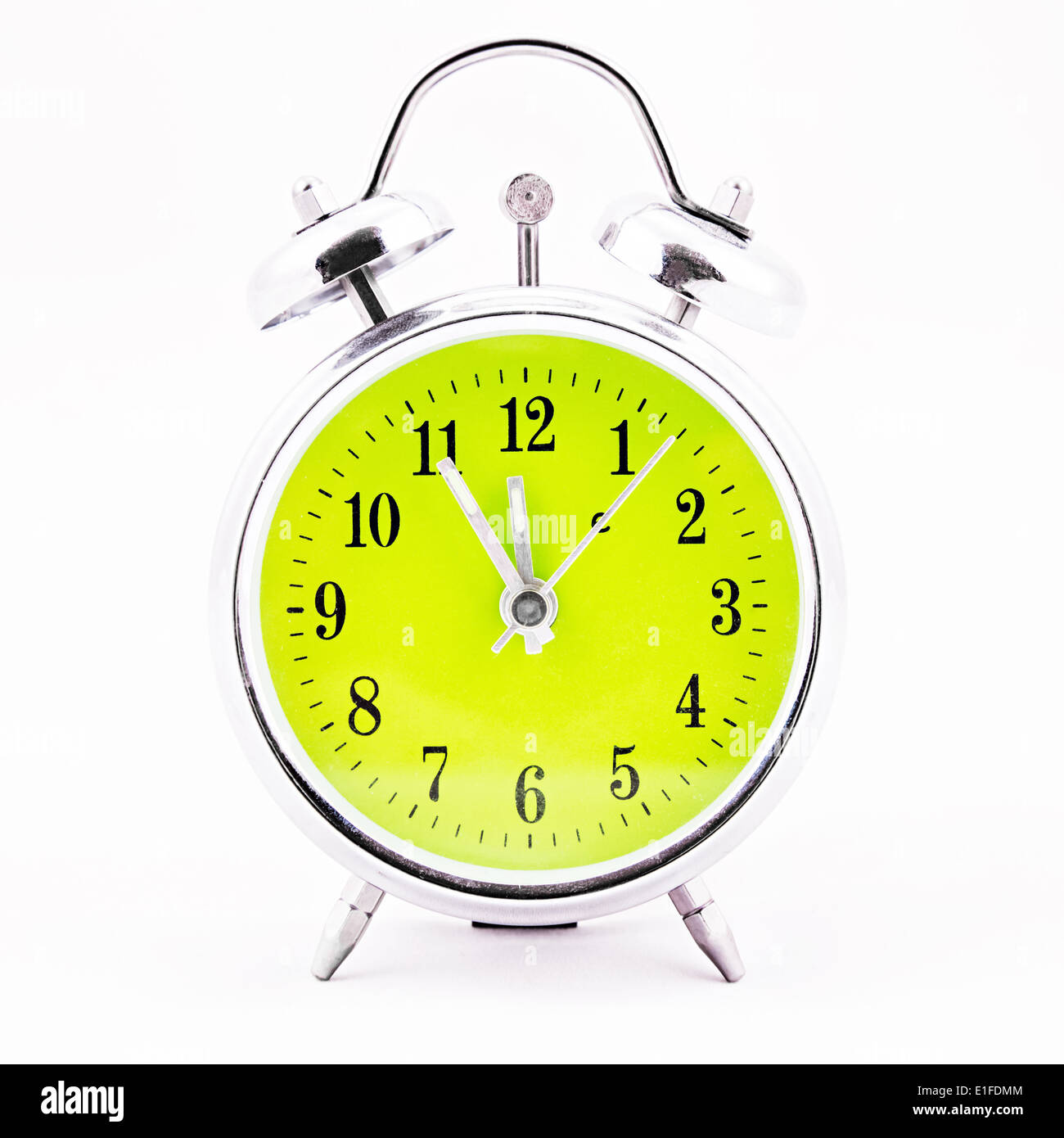 Alarm clock on white background. Showing time five minutes before twelve Stock Photo
