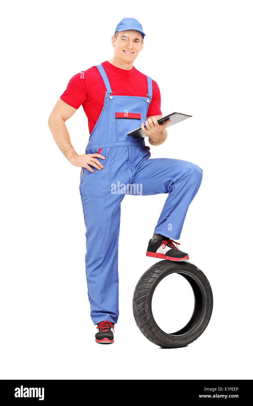 Full length portrait of a mechanic holding a clipboard Stock Photo