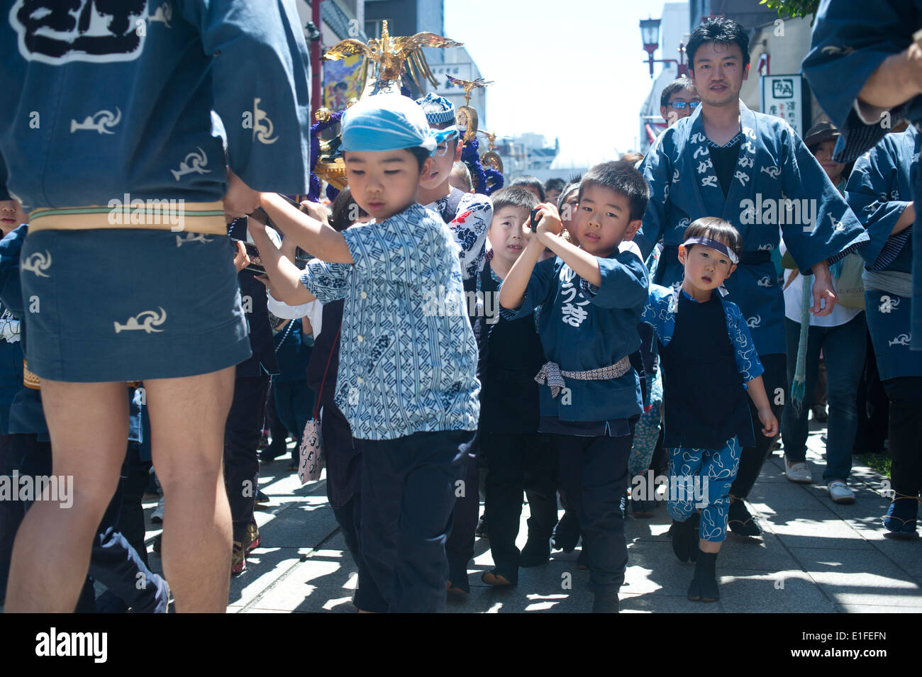 Tokyo Japan 2104 - Kids carrying a shrine during Sanja Matsuri festival - Stock Image