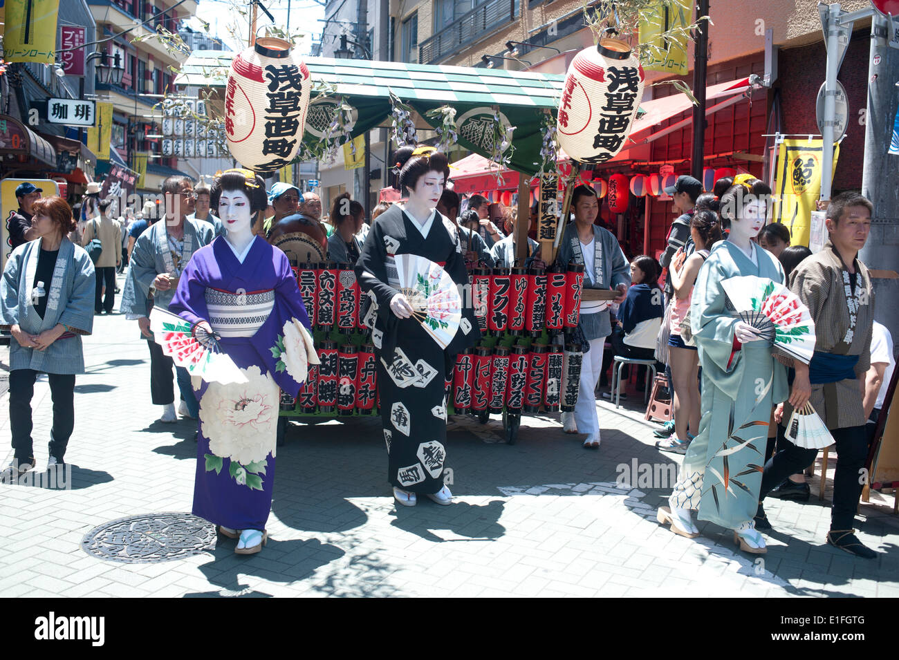 Tokyo, Japan - May 2014 - People attend to see carrying portable Shinto Temples (Mikoshi) during the Sanja Matsuri in Asakusa - Stock Image