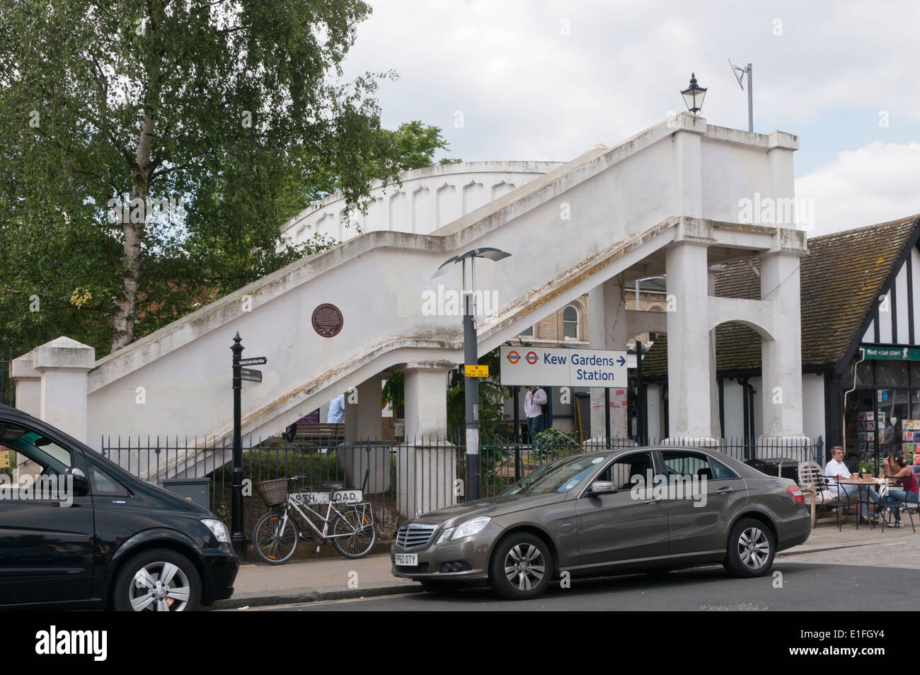 Historic reinforced concrete footbridge at Kew Gardens Station. - Stock Image