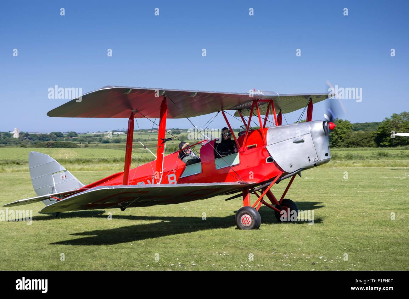 DH82A De Havilland Tiger Moth G-BYLB biplane at Northrepps Airfield Norfolk - Stock Image