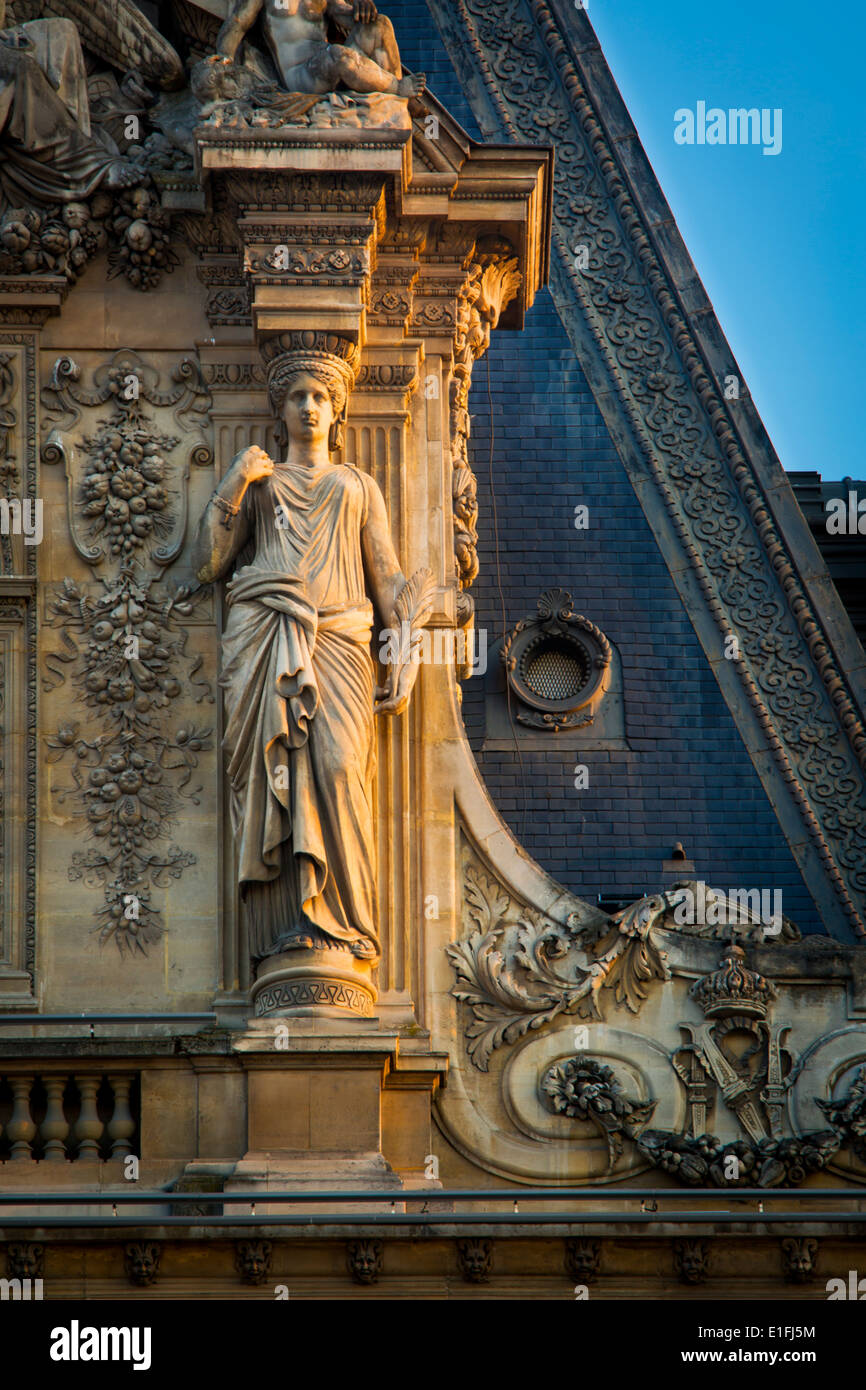 Caryatid, sculpted female architectural feature at Musee du Louvre, Paris France - Stock Image