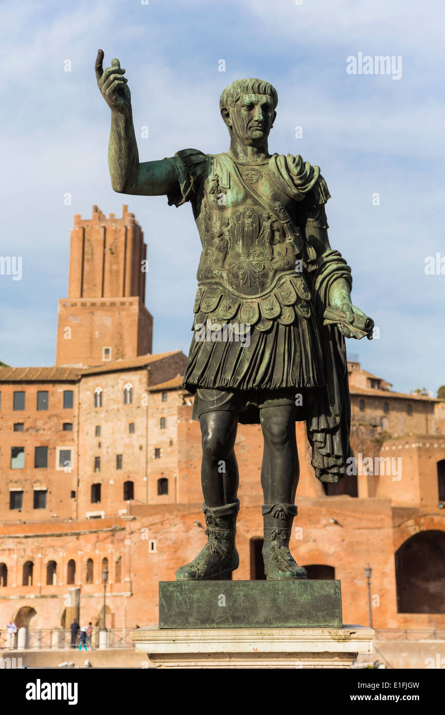 Rome, Italy. Statue of the Emperor Trajan with Trajan's Forum behind. - Stock Image