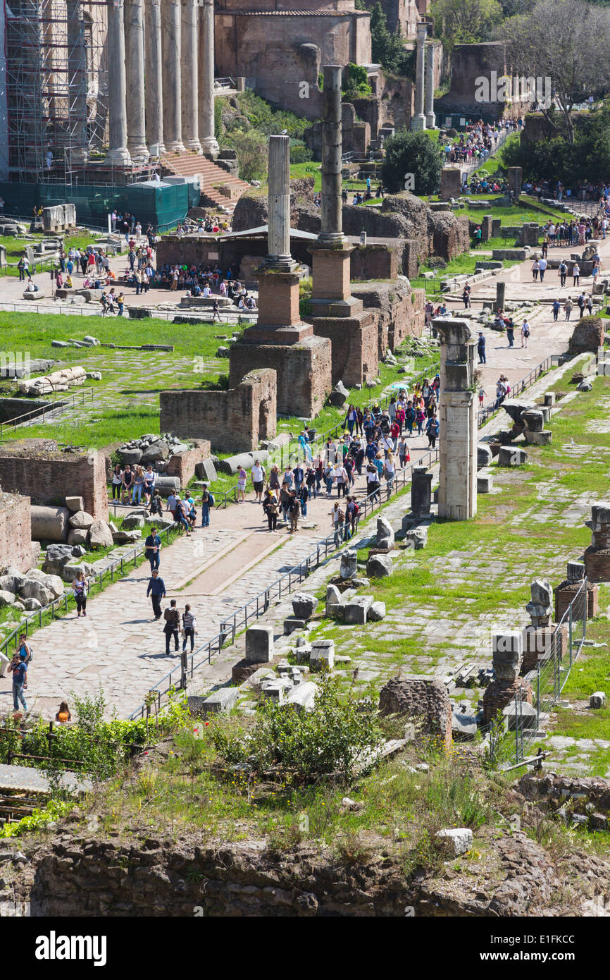 Rome, Italy. Visitors on the Via Sacra in the Roman Forum. - Stock Image