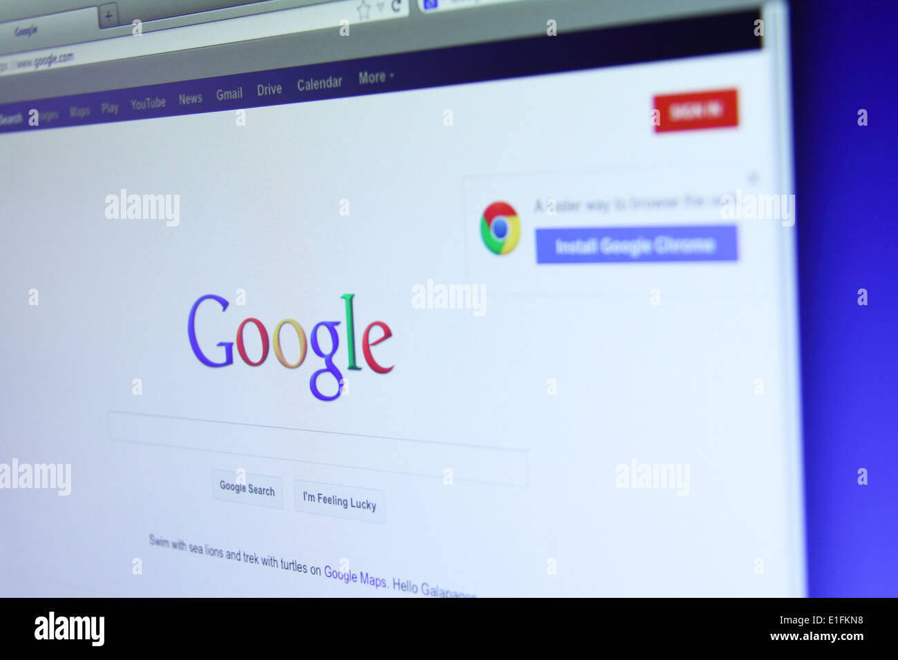 Photo of Google website on a monitor screen. Google Inc. is an American multinational corporation specializing in Stock Photo