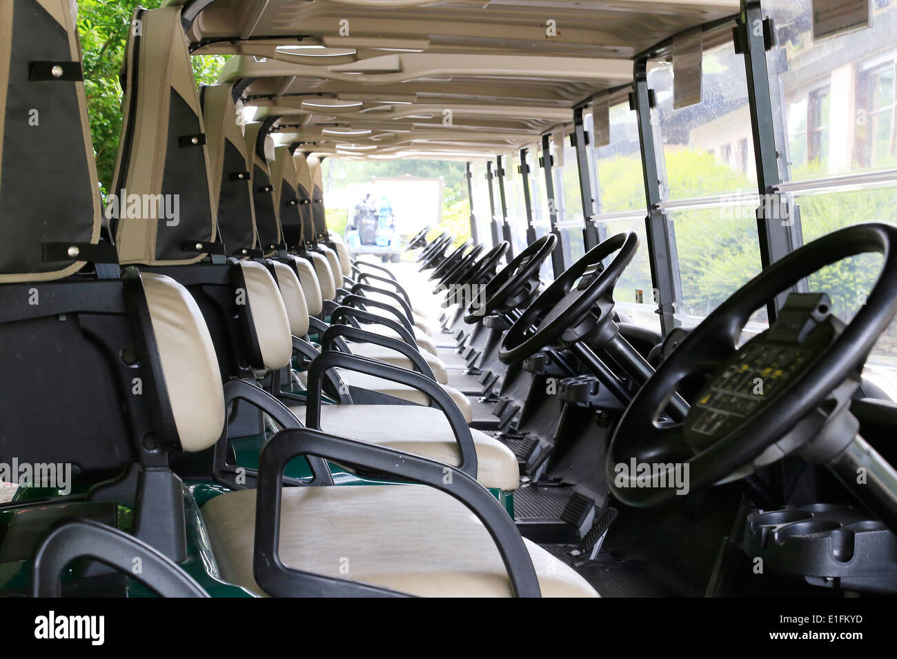 Golf carts buggies lined up ready to go - Stock Image