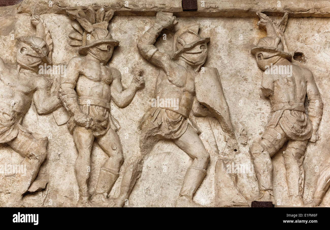 Rome, Italy. Bas relief in the Colosseum of gladiators fighting. - Stock Image
