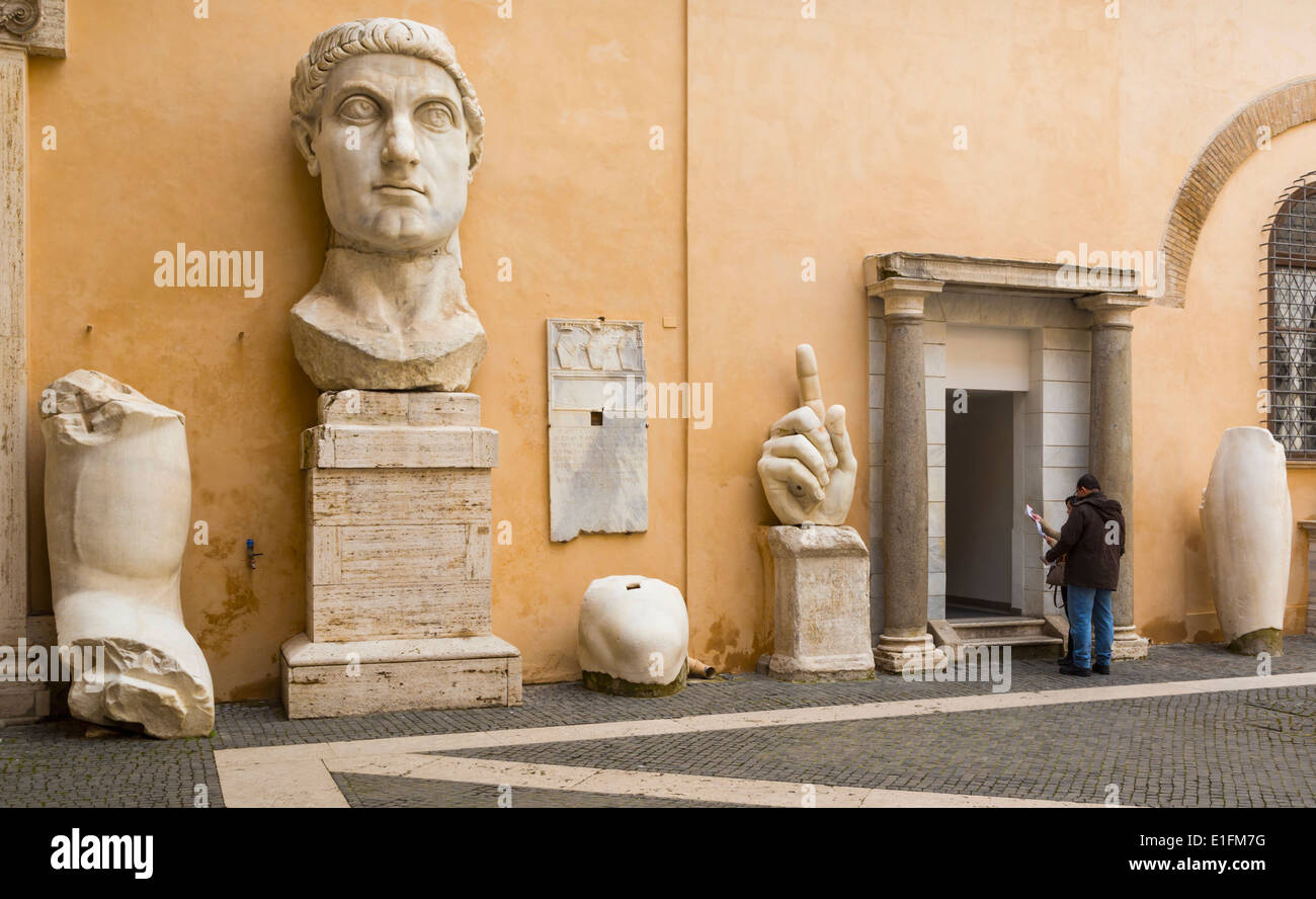 Rome, Italy. The Capitoline Museum. Courtyard Palazzo dei Conservatori. Pieces of the colossal statue of the Emperor Constantine - Stock Image
