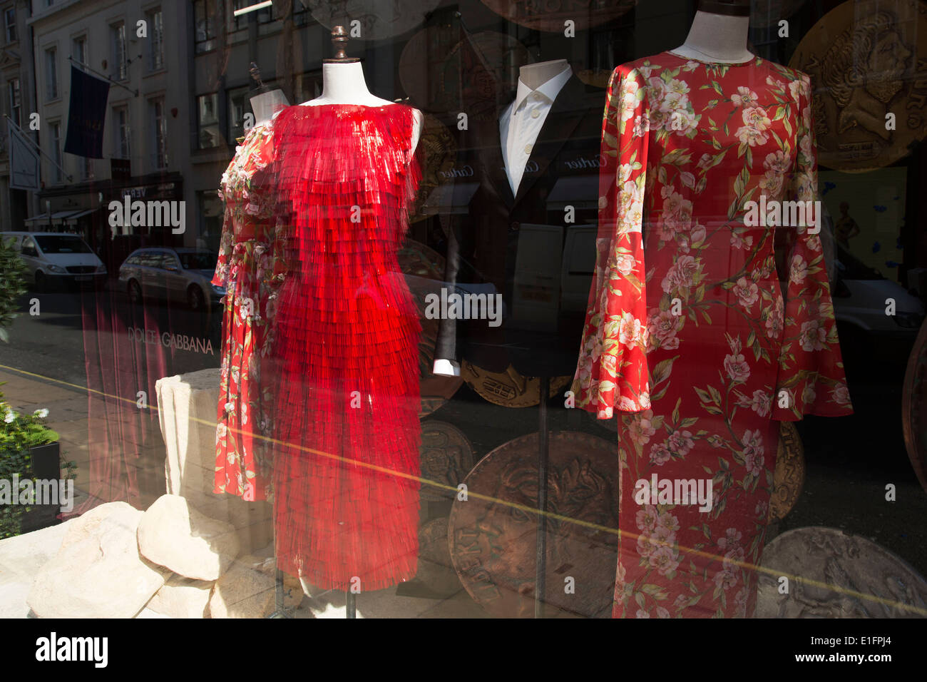 5353c89f4d Red dresses for sale in the Dolce and Gabbana shop on Bond Street, London,  UK.