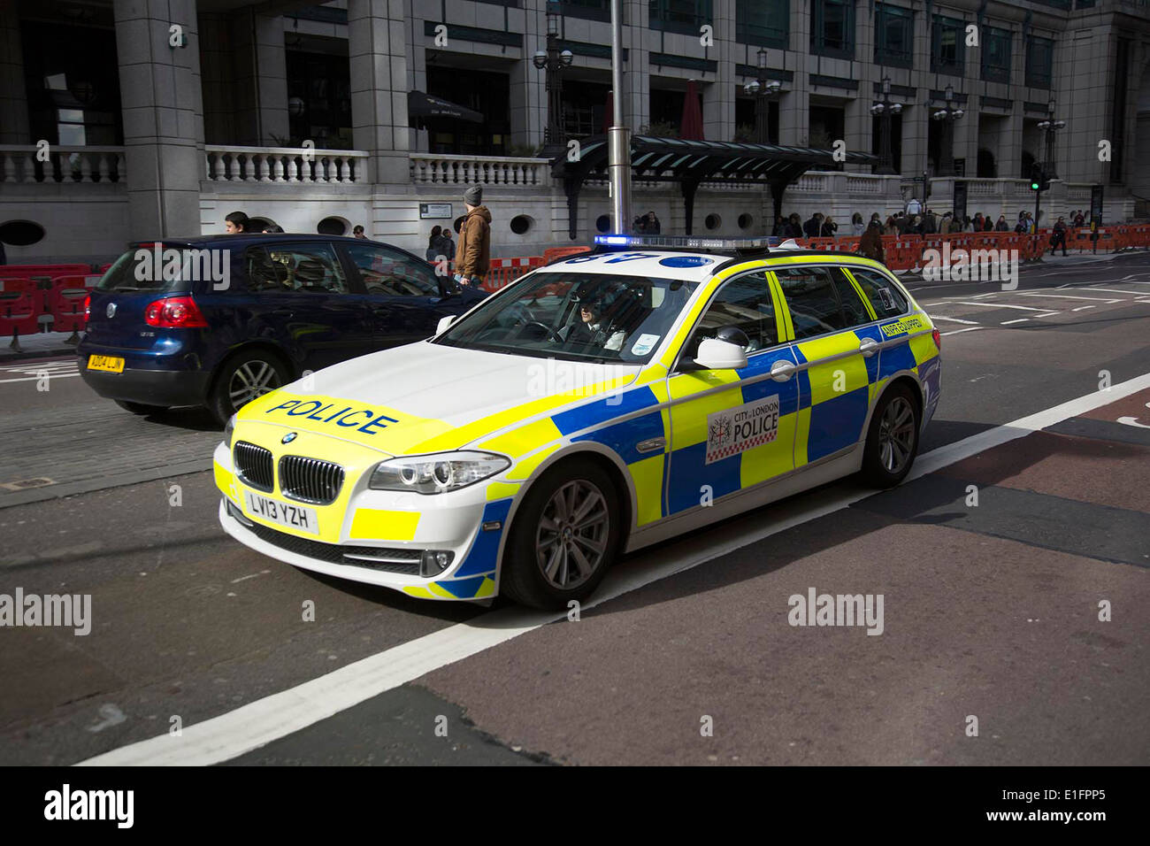 Police car passes at speed in the City of London, UK. Stock Photo