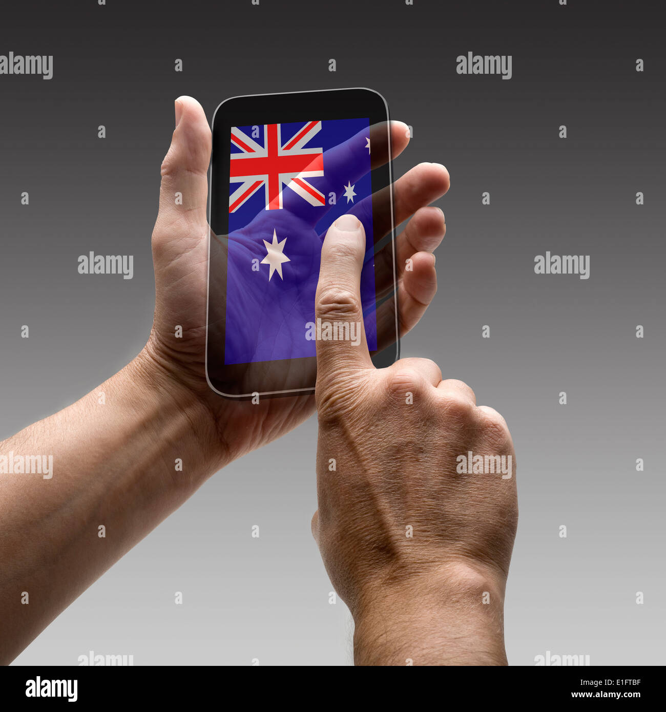 Holding Australia flag screen smart phone. There is a route for hand and finger. - Stock Image