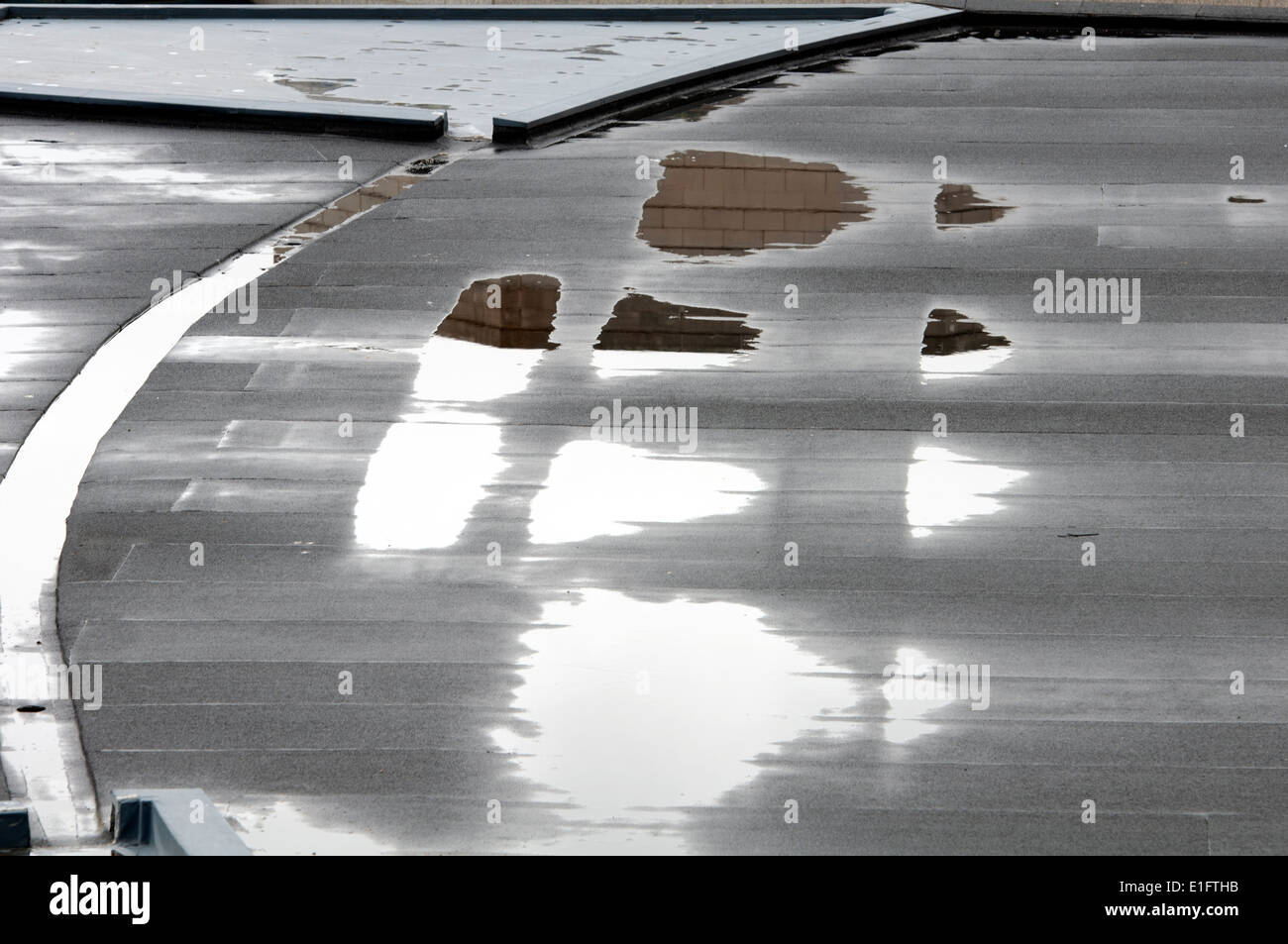 Flat roof of the REP theatre with puddles, Birmingham, UK - Stock Image