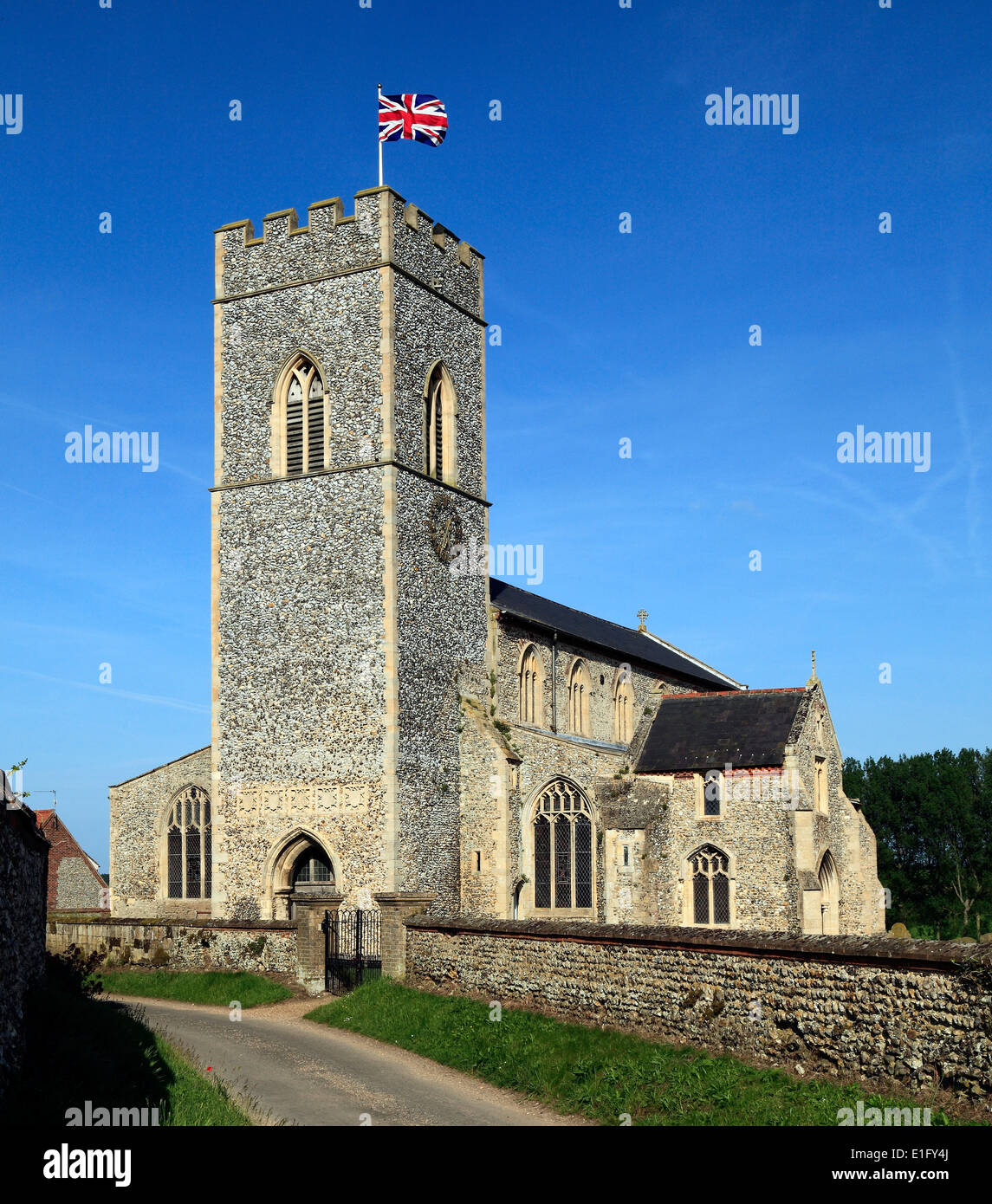 English Medieval church, Union Jack Flag, Wighton, Norfolk England UK English churches tower towers flying flags - Stock Image
