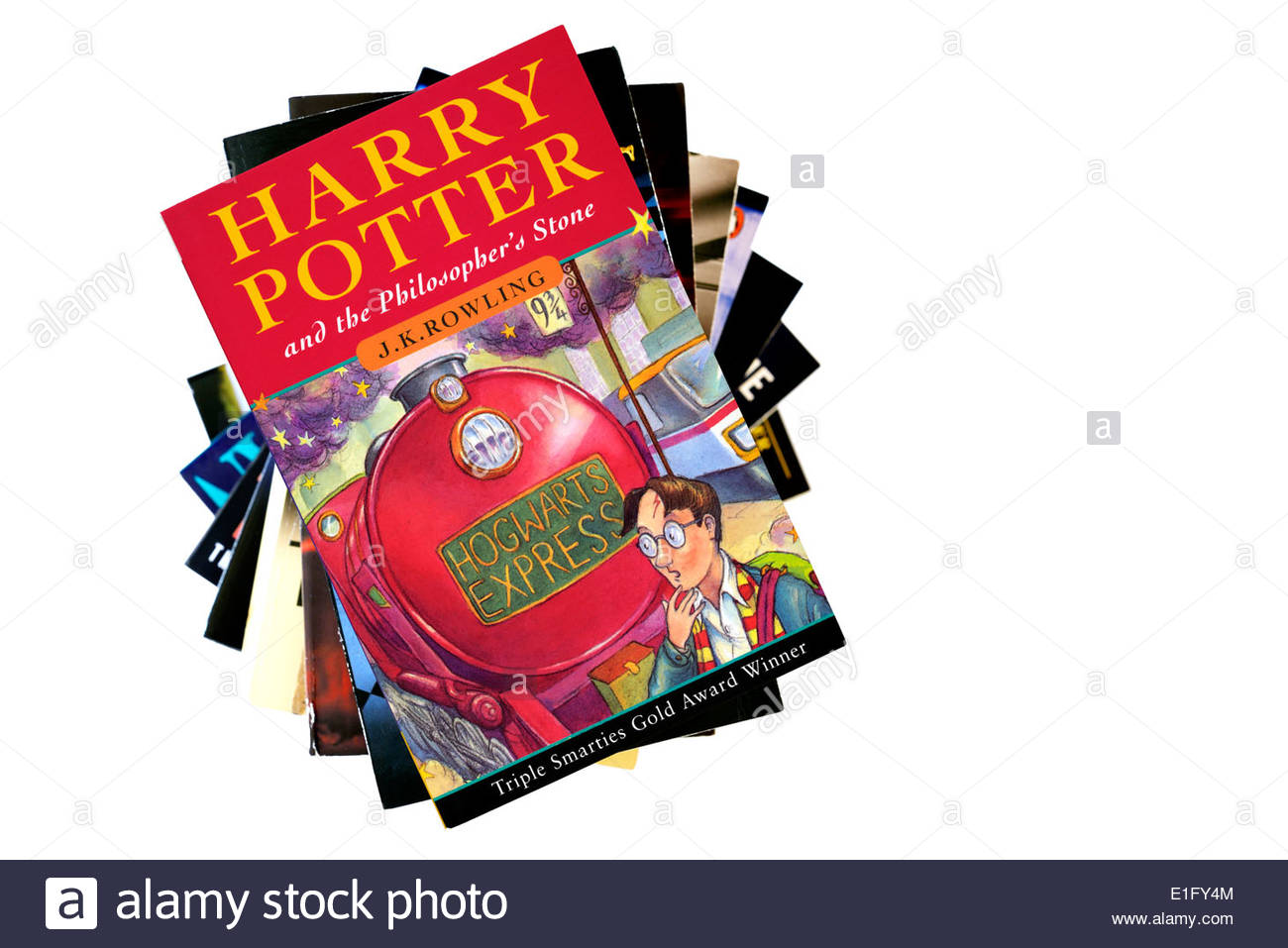 Harry Potter and the Philosopher's Stone by J K Rowling, paperback title stacked used books, England - Stock Image
