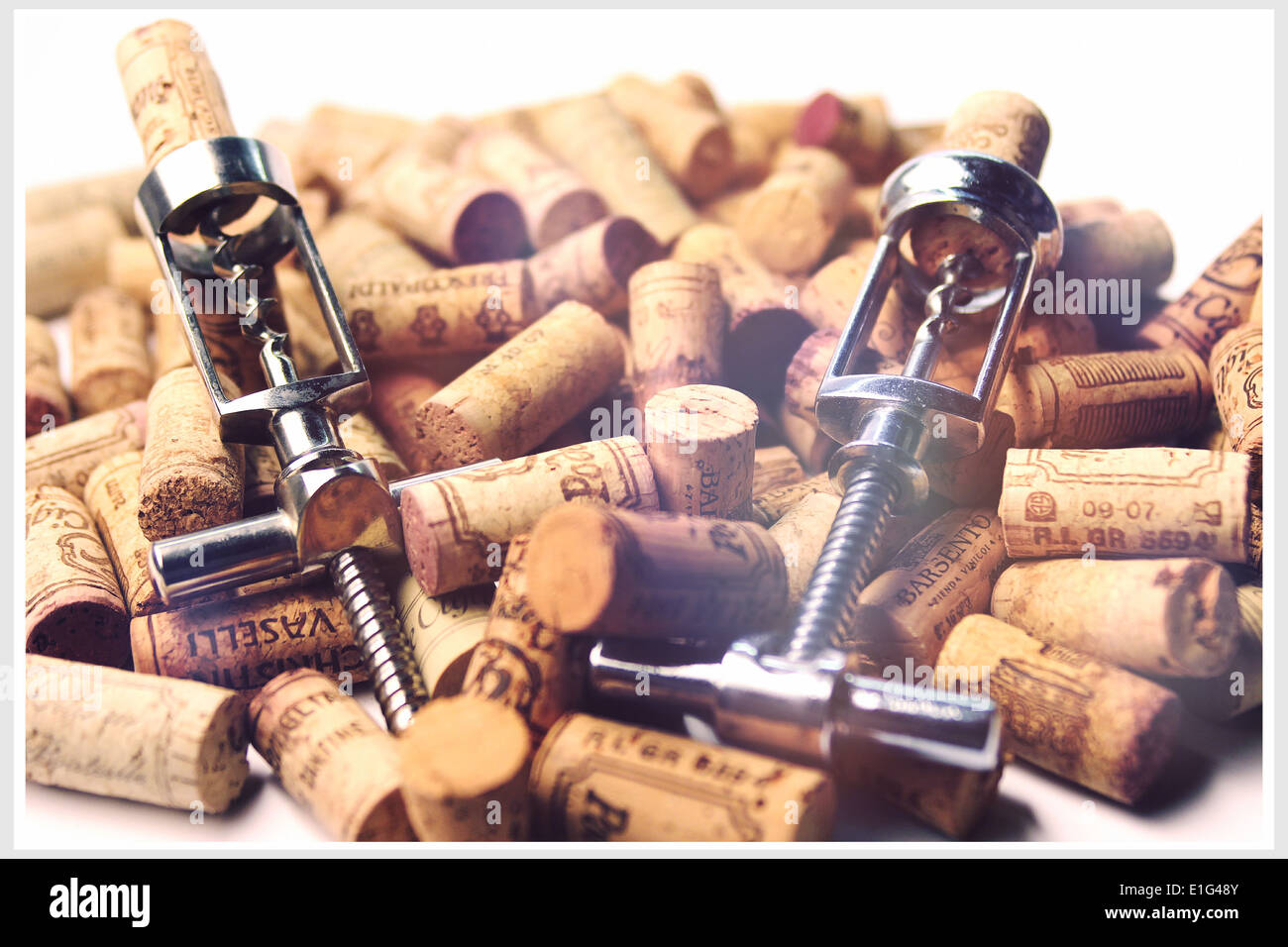 Corks of different Italian wines and corkscrews - Stock Image
