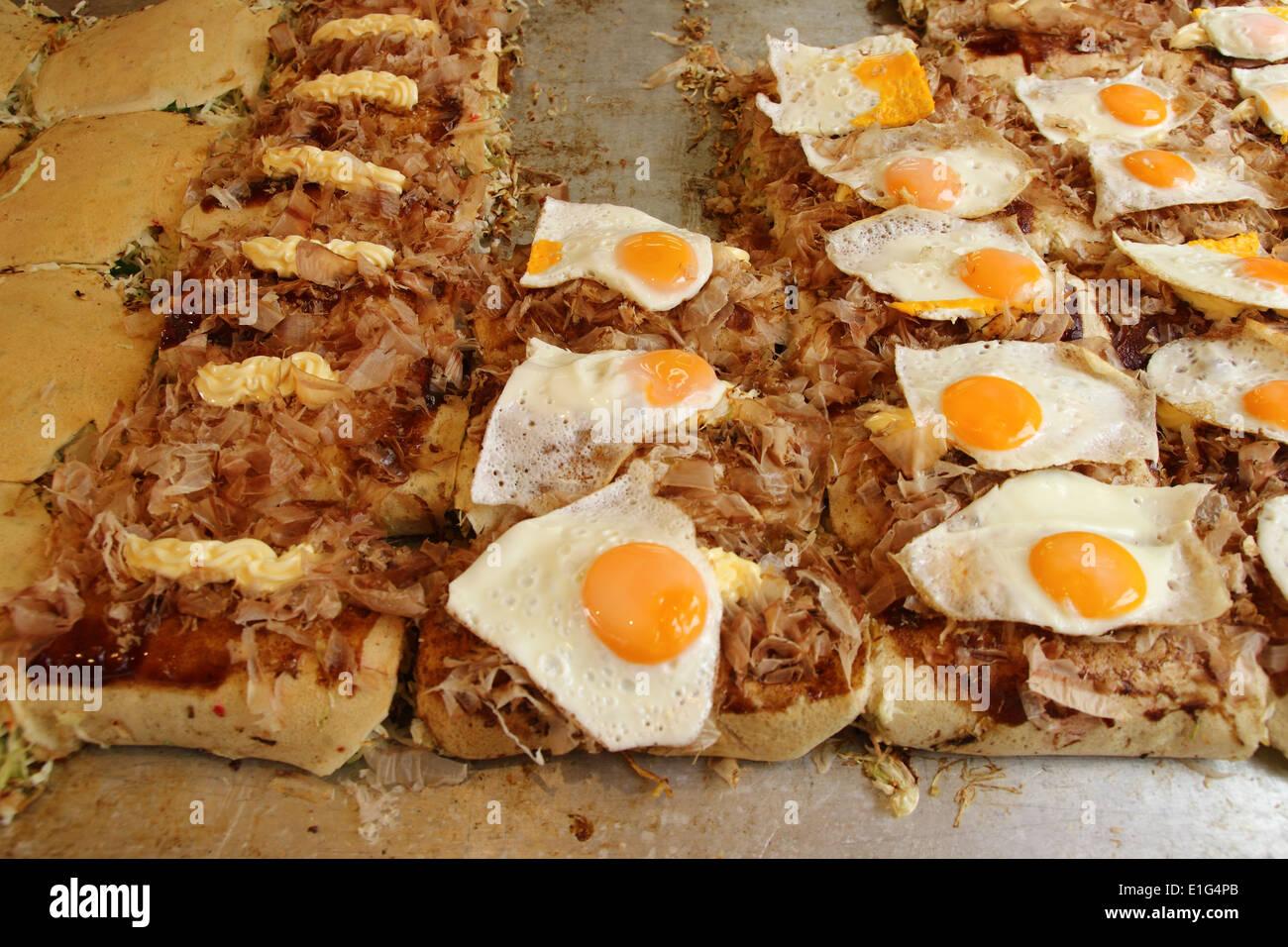 Japanese food Okonomiyaki is japanese pizza Stock Photo