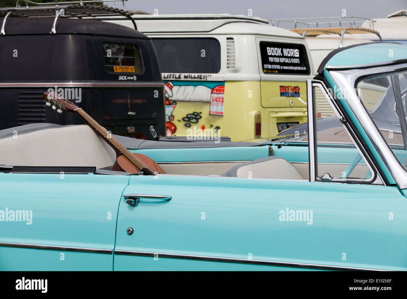 Guitar On The Back Seat Of A Convertible Light Blue Cadillac Stock Photo Alamy