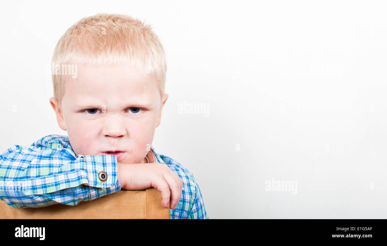 Angry little boy with a bad temper - Stock Image