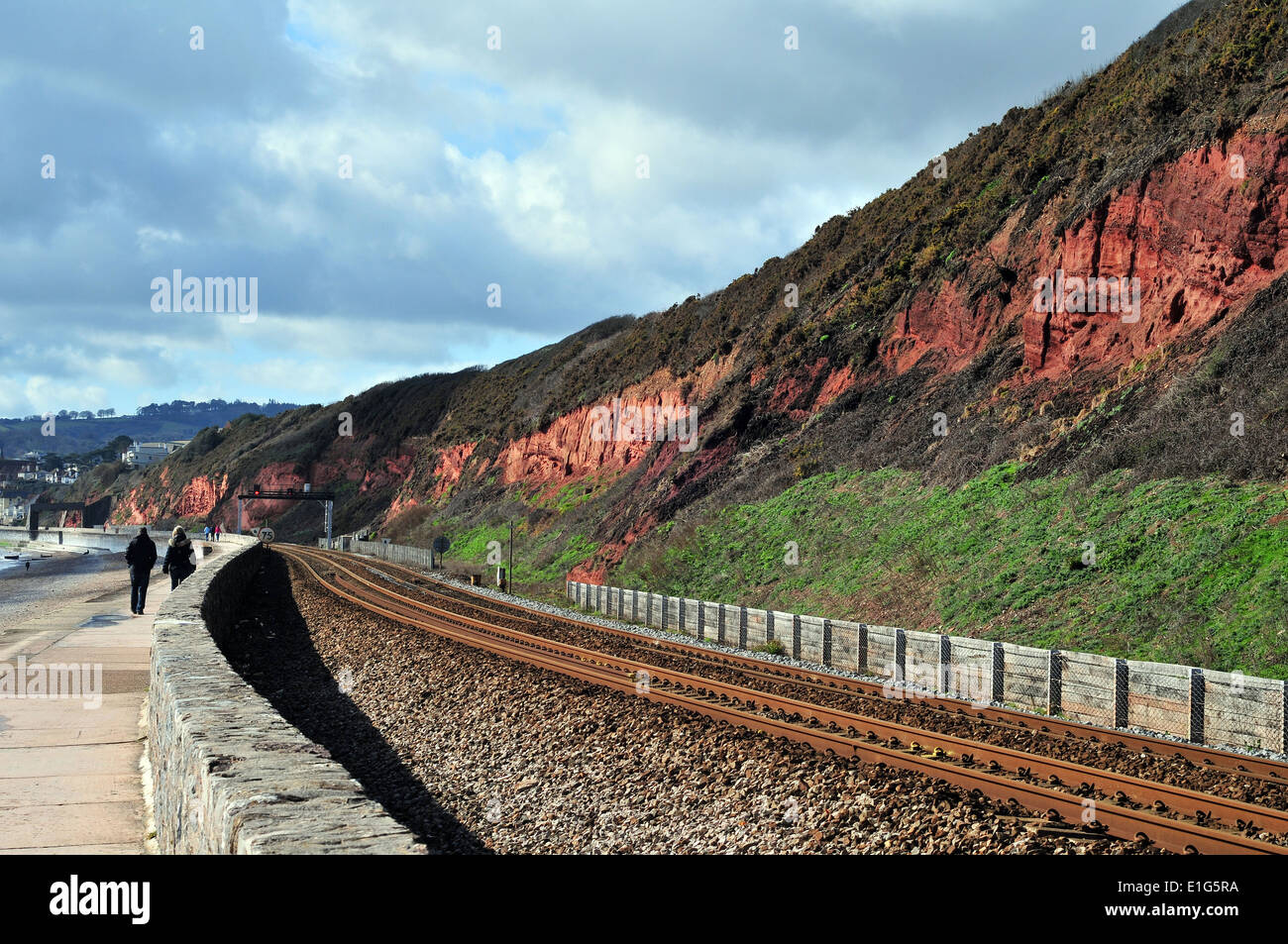 A cliff section of Old Red Sandstone near, Dawlish, South Devon - showing Devonian stratigraphy and the railway line. - Stock Image