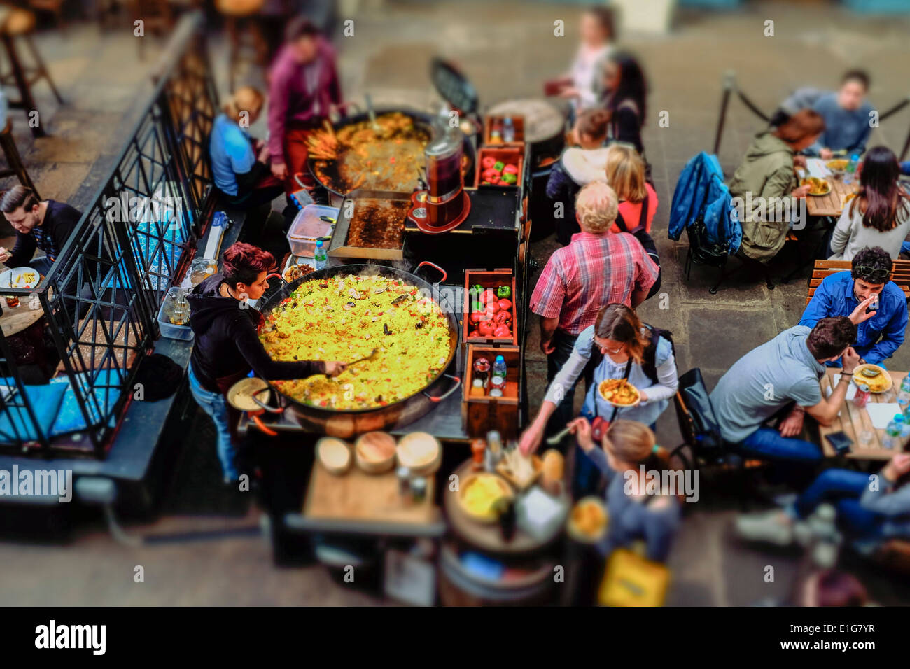 Food stall cooking large Paella dish, Covent Garden, London, UK - Stock Image