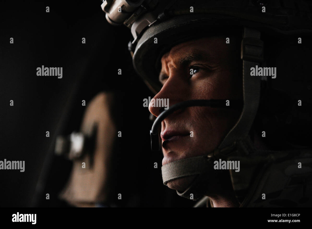U.S. Air Force Tech. Sgt. Anthony Wood, a pararescueman with the 46th Expeditionary Rescue Squadron, scans his sector during a - Stock Image